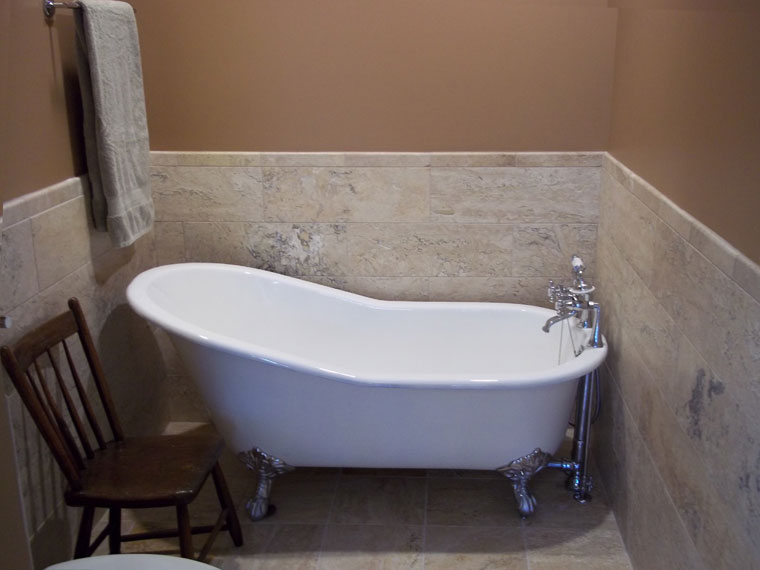 Luxuious new footed bath tub and stone tile in Hinsdale, IL